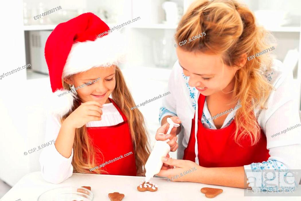 Stock Photo: Decorating the gingerbread cookies.