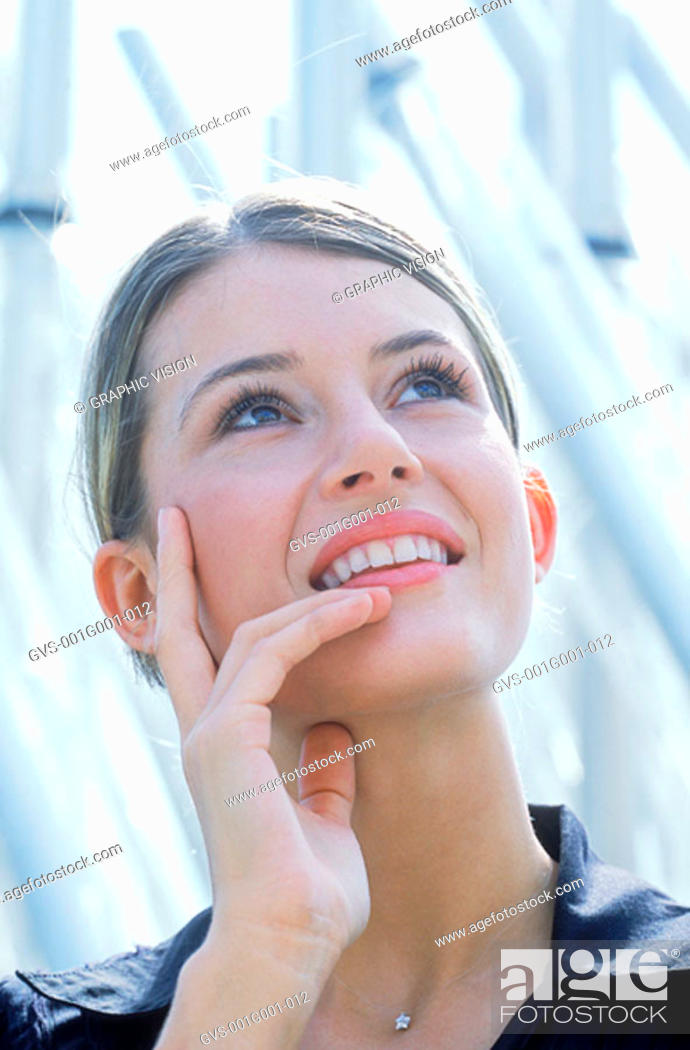 Stock Photo: Portrait of a Young Woman With Blonde Hair Looking Up.