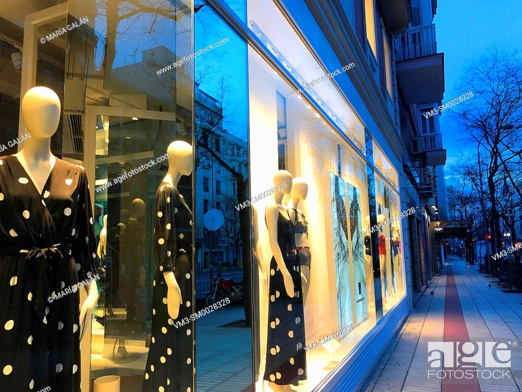 Stock Photo: Shop window and street at dawn. Madrid, Spain.