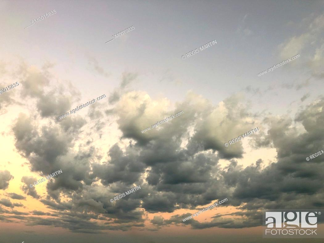 Stock Photo: Clouds at sunset with diminishing perspective and copy space.