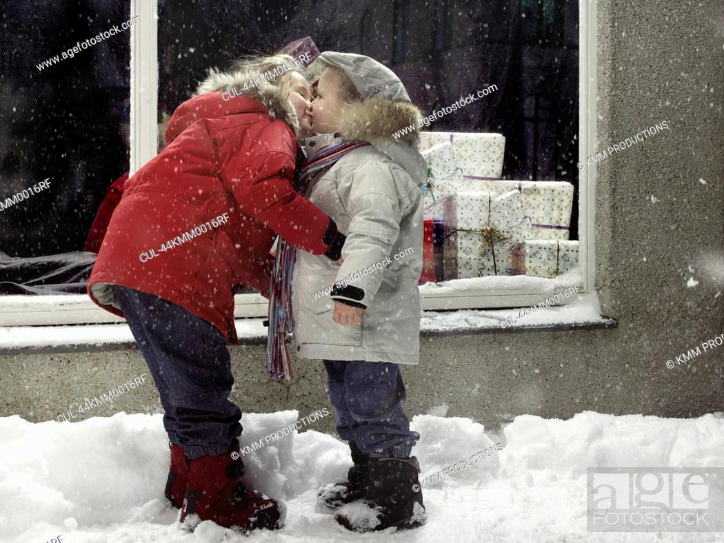Stock Photo: Children kissing in snow.