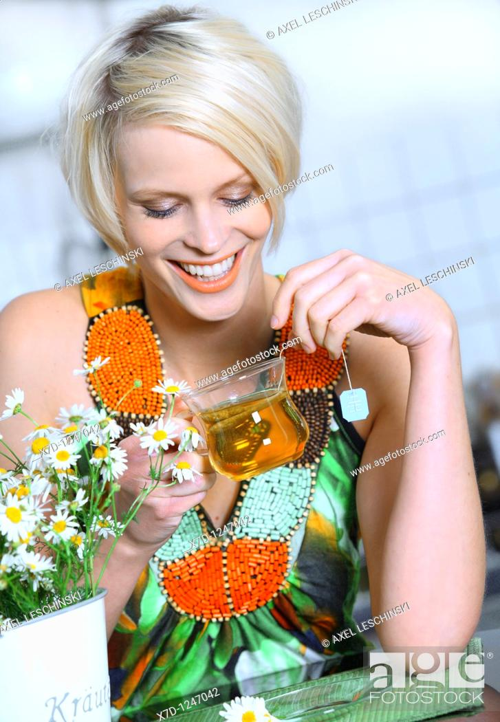 Stock Photo: young woman drinking a cup of tea.