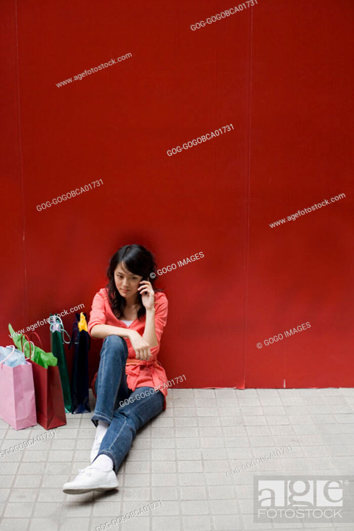 Stock Photo: Young woman talking on her cell phone.