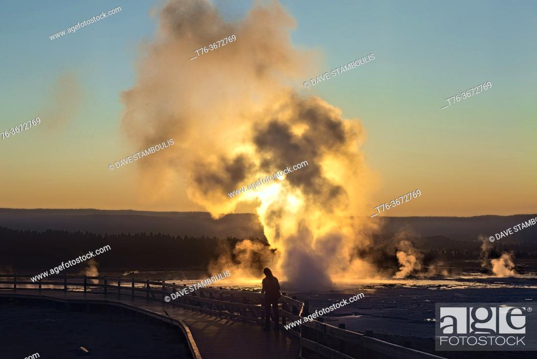 Stock Photo: Clepsydra Geyser erupting at sunset, Lower Geyser Basin, Yellowstone National Park, Wyoming, USA.