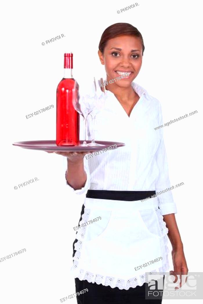 Stock Photo: Young waitress with a bottle of rose wine and two glasses.