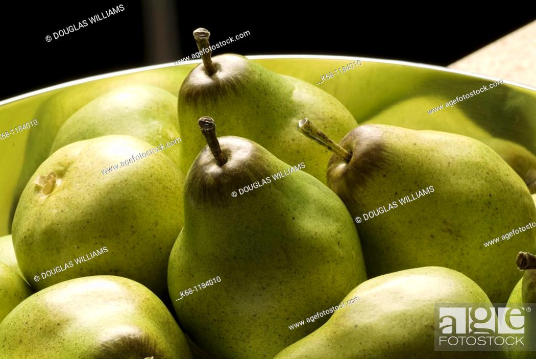 Stock Photo: plastic pears in a bowl.