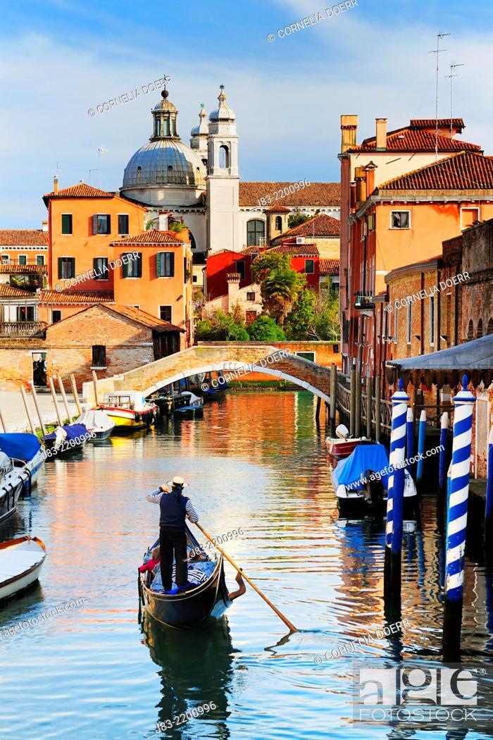 Stock Photo: Gondolier on Rio Ognissanti and Church of San Trovaso, Venice, Veneto, Italy, Europe.