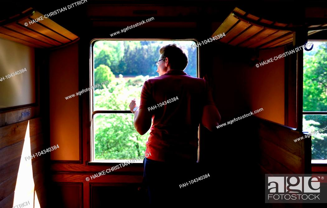 Stock Photo: A man looks out of a historic railroad waggon at Minett Park Fond-de-Gras near Niedercorn (Luxemburg), 06 May 2018. | usage worldwide.