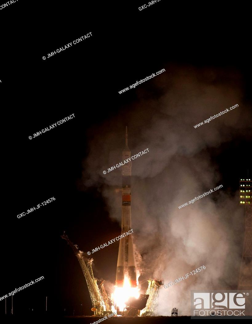 Stock Photo: The Soyuz TMA-01M rocket launches from the Baikonur Cosmodrome in Kazakhstan (Oct. 7 in the U.S., Oct. 8 in Kazakhstan) carrying Expedition 25 crew members --.