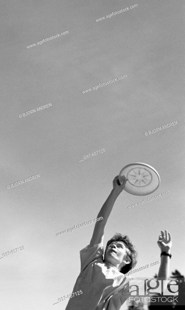 Stock Photo: Boy catching frisbee.