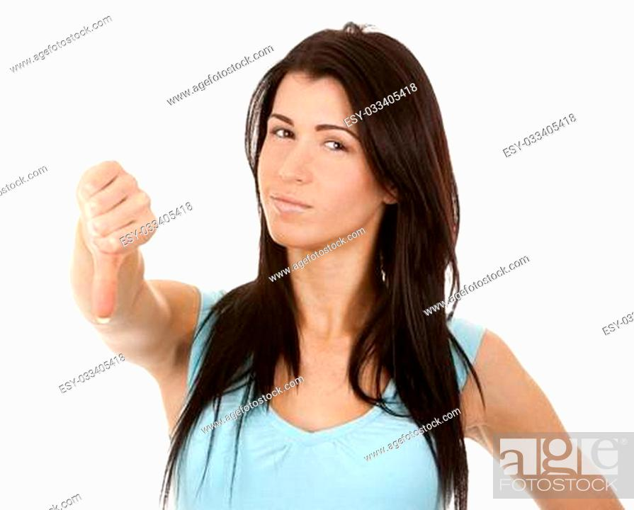 Stock Photo: casual brunette showing thumb down gesture on white background.