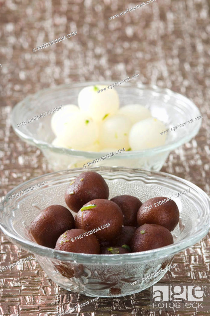 Stock Photo: Close-up of Gulab Jamuns and Rasgullas in two bowls.
