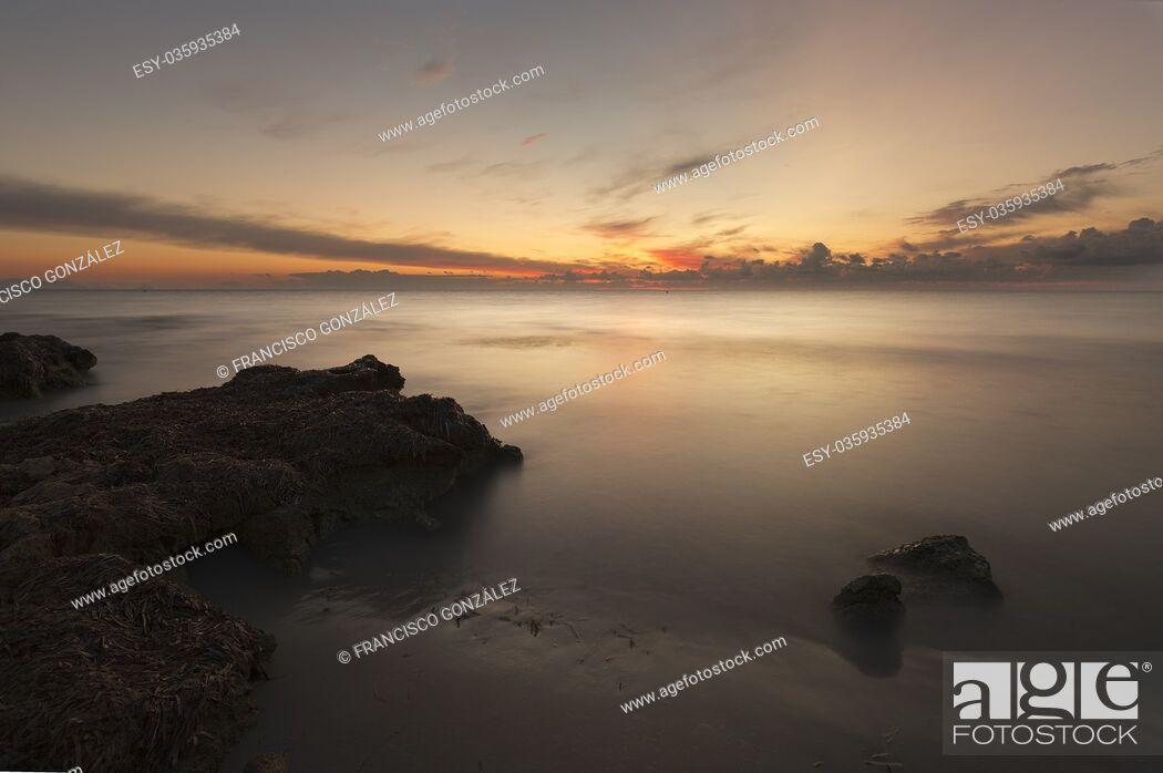 Stock Photo: Sunrise on a beach in Santa Pola, Alicante province, Spain.