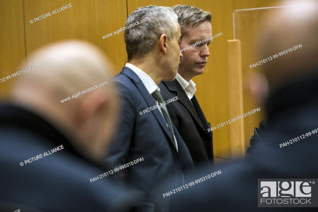 Stock Photo: 12 January 2021, Hessen, Frankfurt/Main: The main defendant Stephan Ernst (center, r) stands next to his lawyer Mustafa Kaplan (center.