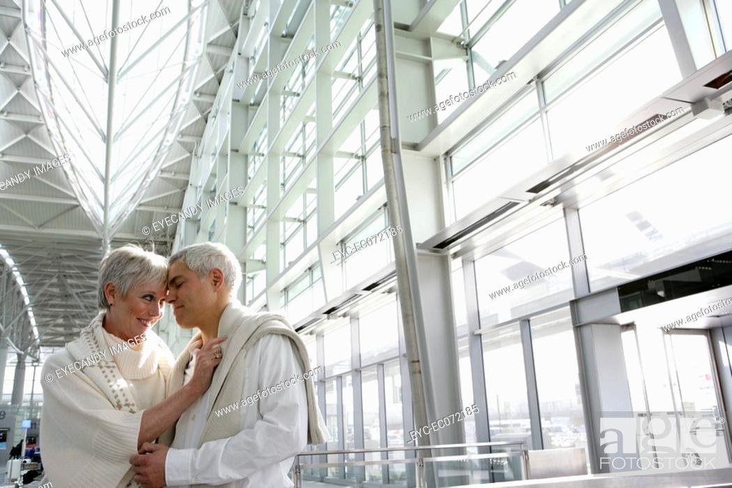 Stock Photo: Romantic mature couple in airport.