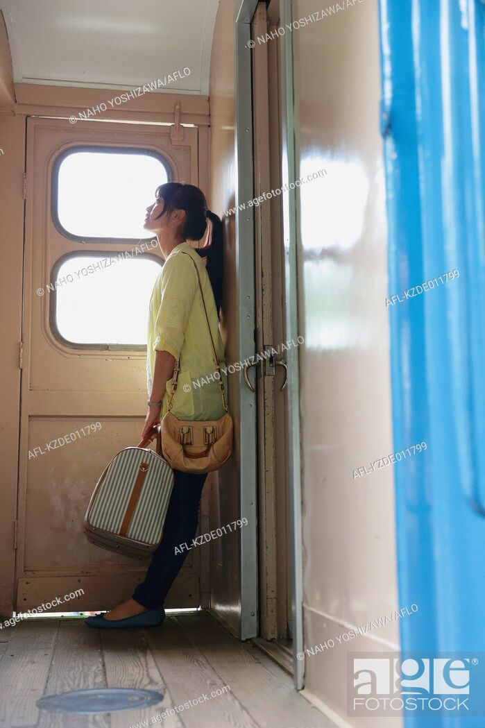 Stock Photo: Young Japanese woman on a train trip.