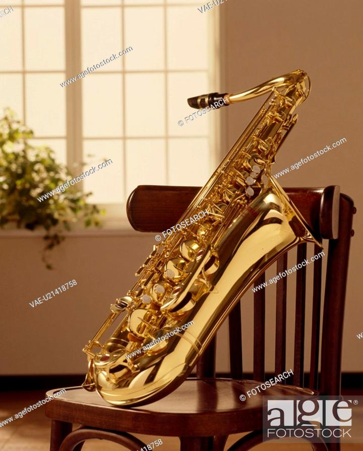 Stock Photo: A Chair And Sax.