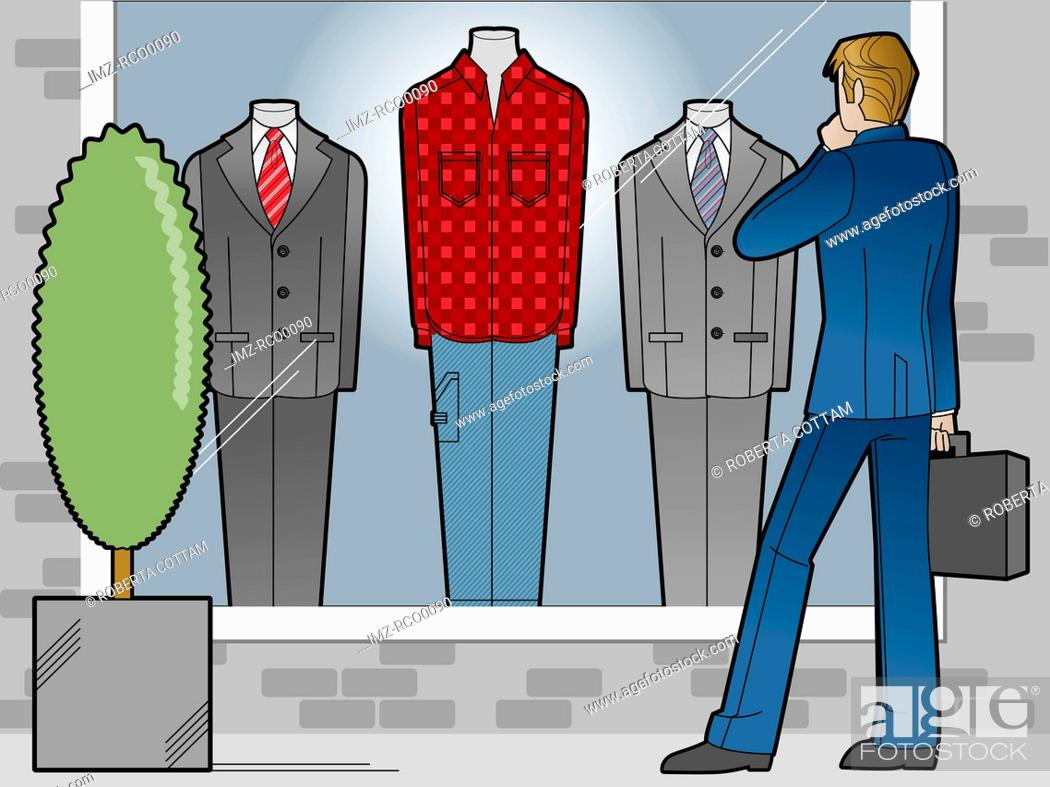 Stock Photo: A man looking at business suits in a window.