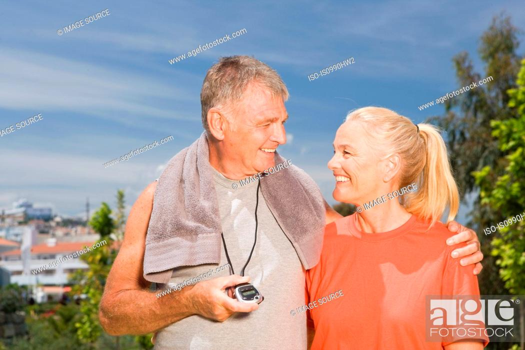 Stock Photo: Mature couple after workout.