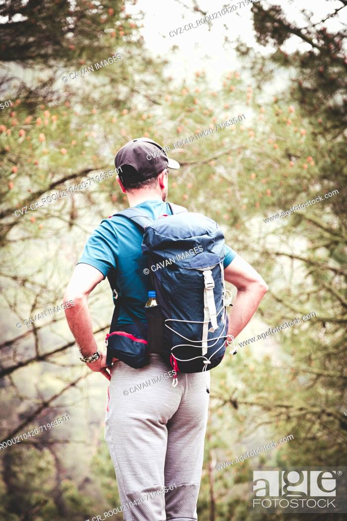 Stock Photo: Man exploring mountain with backpack.