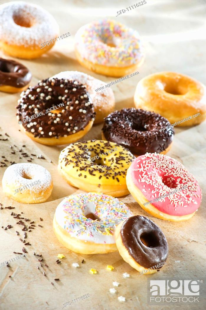 Doughnuts with colourful glaze and sugar sprinkles, Stock