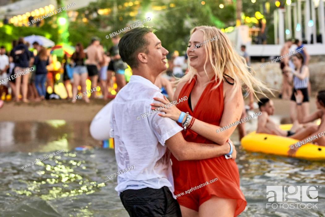 Stock Photo: Greece, Crete, Chersonissos, couple at Beach Party in sea, flirting.