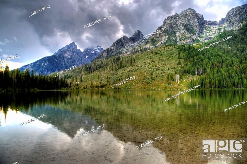 Stock Photo: The Tetons are reflected in String Lake at Grand Teton National Park, Wyoming.