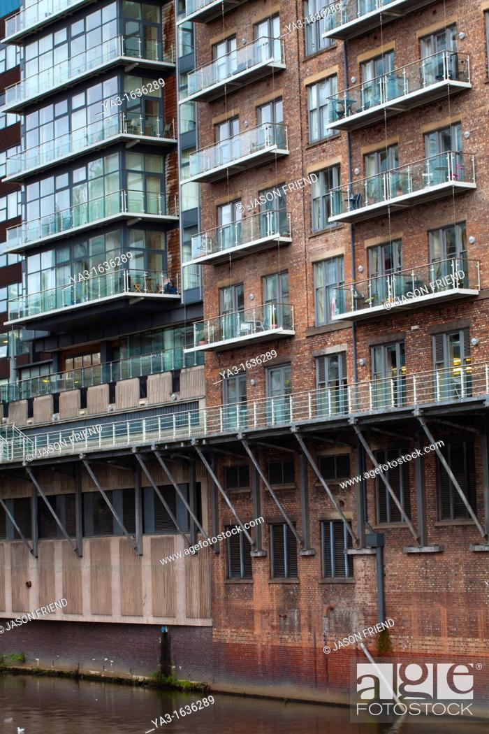 Stock Photo England Greater Manchester Detail Shot Of Modern Apartments Formed By Redevolping Victorian Warehouses Located On The Banks