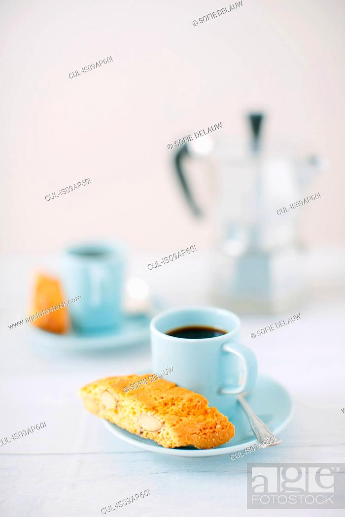 Stock Photo: Still life of black coffee and almond cantucci biscuits.