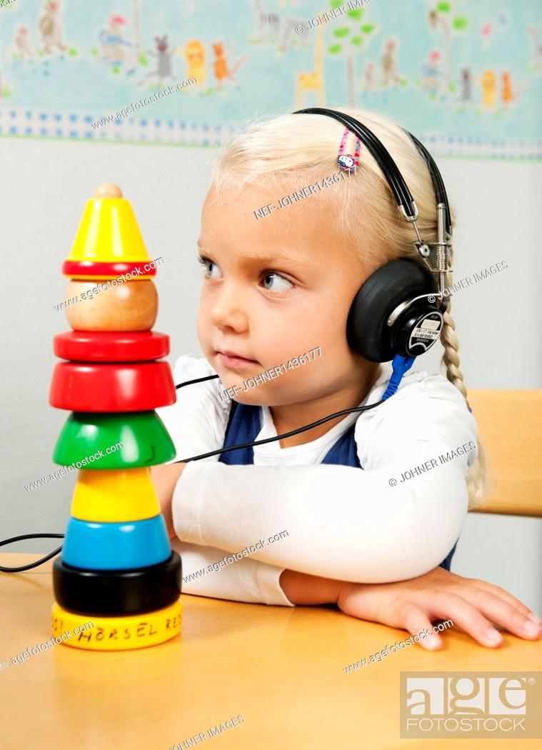 Stock Photo: Girl with headphones during hearing control.