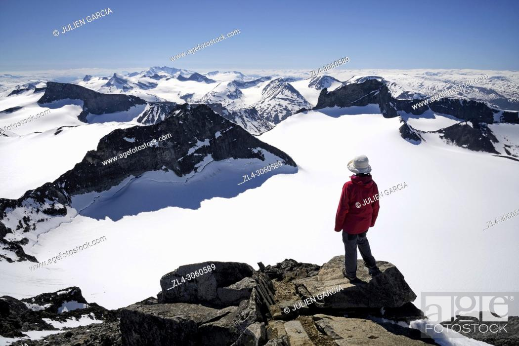Stock Photo: Norway, Oppland, Vaga, Jotunheimen National Park, trekker at the summit of Galdhopiggen, the tallest mountain in Norway and Scandinavia at 2469m, Model Released.