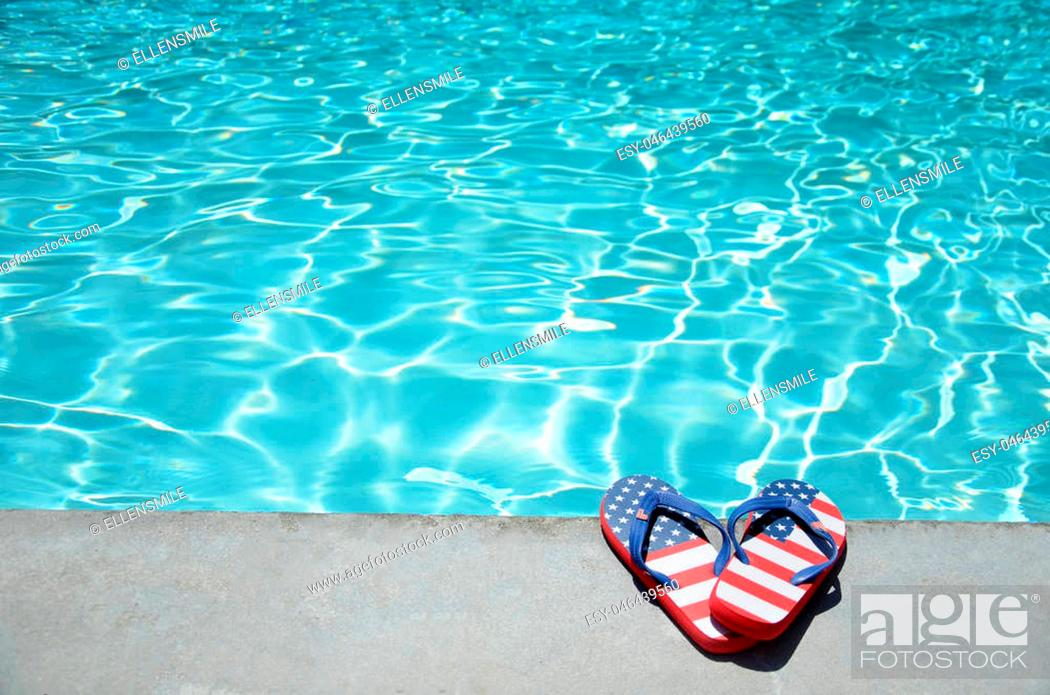 Imagen: Summer background with flip flops of American flag colors and pattern near the swimming pool.