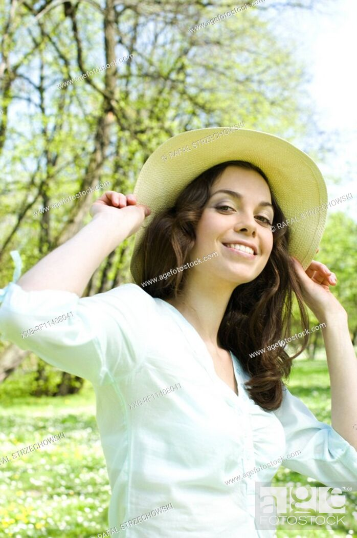 Stock Photo: Woman in straw hat.