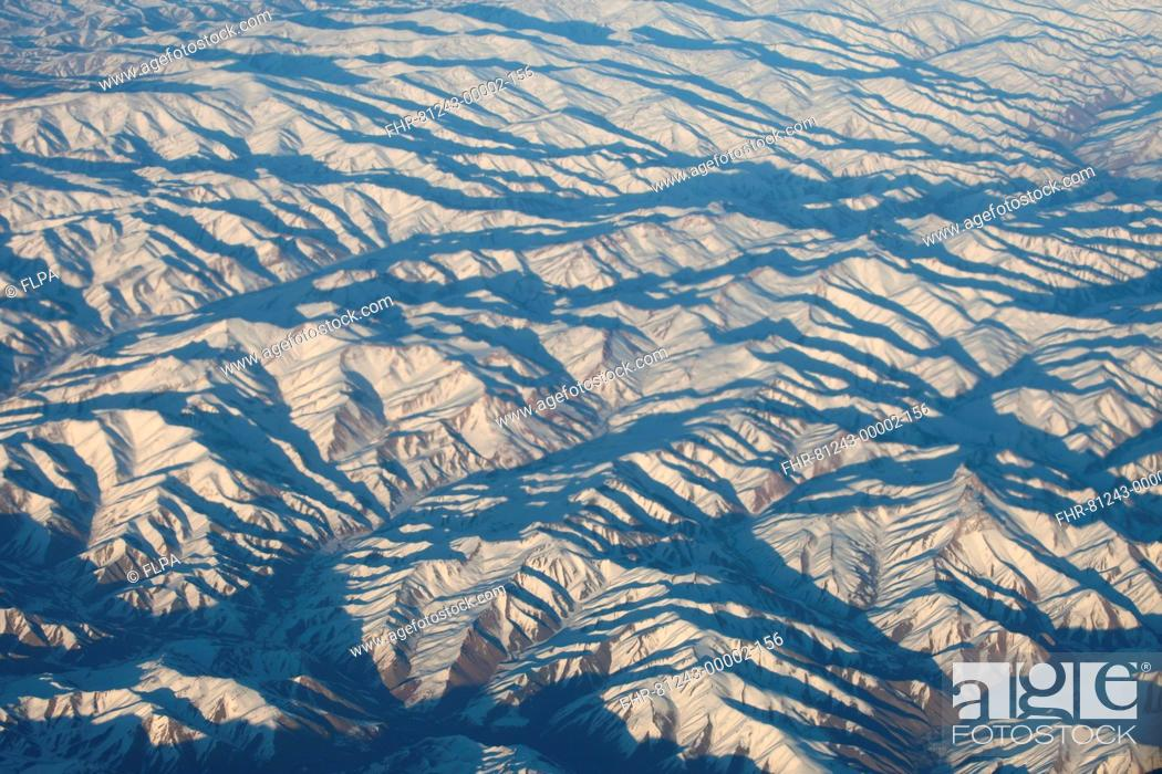 Stock Photo: Aerial view of snow covered mountain range, Afghanistan, november.
