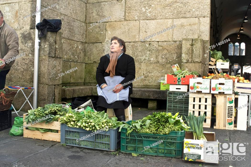 Stock Photo: Woman sellin vegetables in the market of Santiago de Compostela. Galicia, Spain.