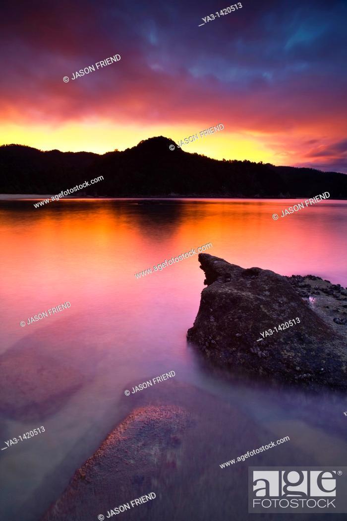 Stock Photo: New Zealand, Nelson, Abel Tasman National Park  Sunset on the coastline by Anchorage Hut, on the coast great walk.