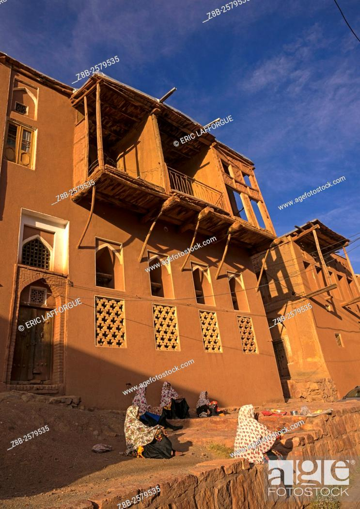 Stock Photo: Old Women In Front Of Ancient Building In Zoroastrian Village, Isfahan Province, Abyaneh, Iran.