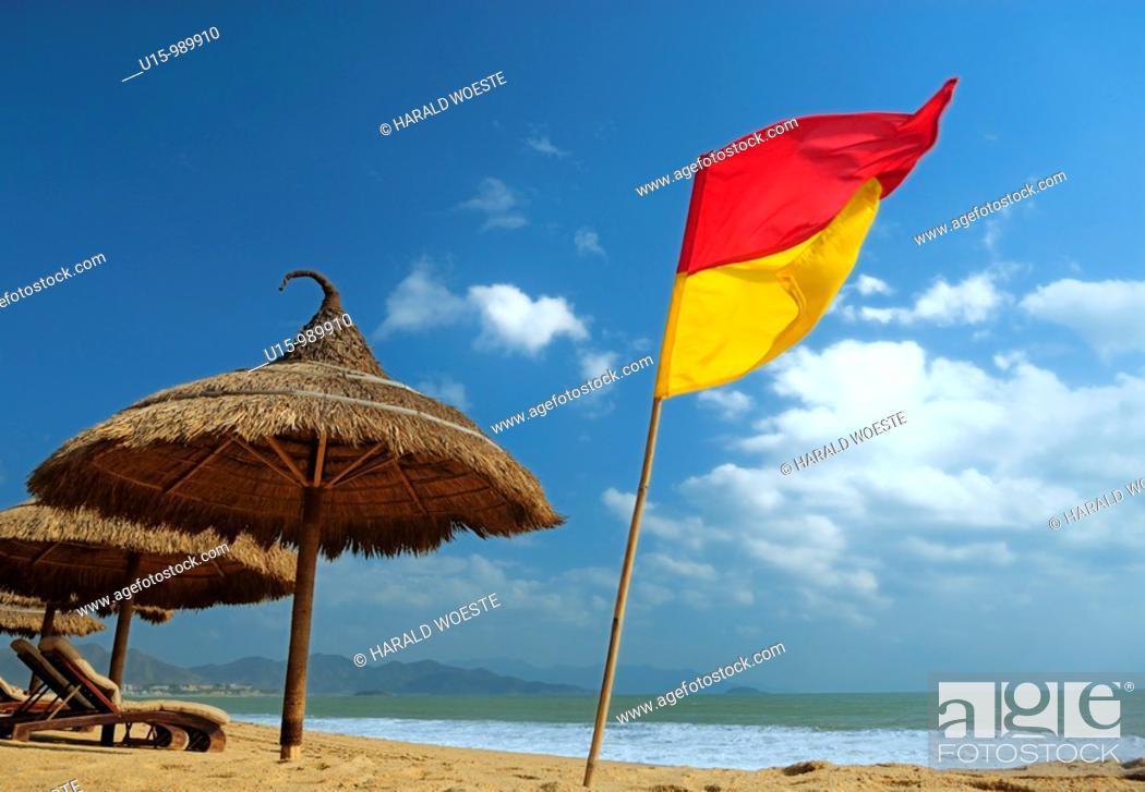 Stock Photo: Sun shade at the 'Sailing Club' beach bar at Nha Trang's beach promenade Tran Phu, Vietnam.