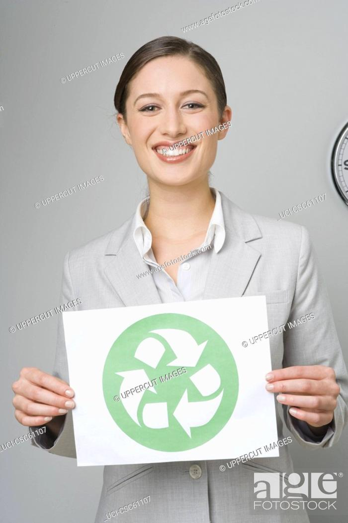 Stock Photo: Businesswoman holding recycling sign.