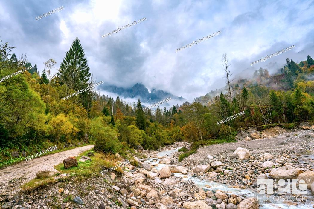 Stock Photo: Panoramic view of the river Torrente Mis near California (Gosaldo) in Italy with low water in autumn.