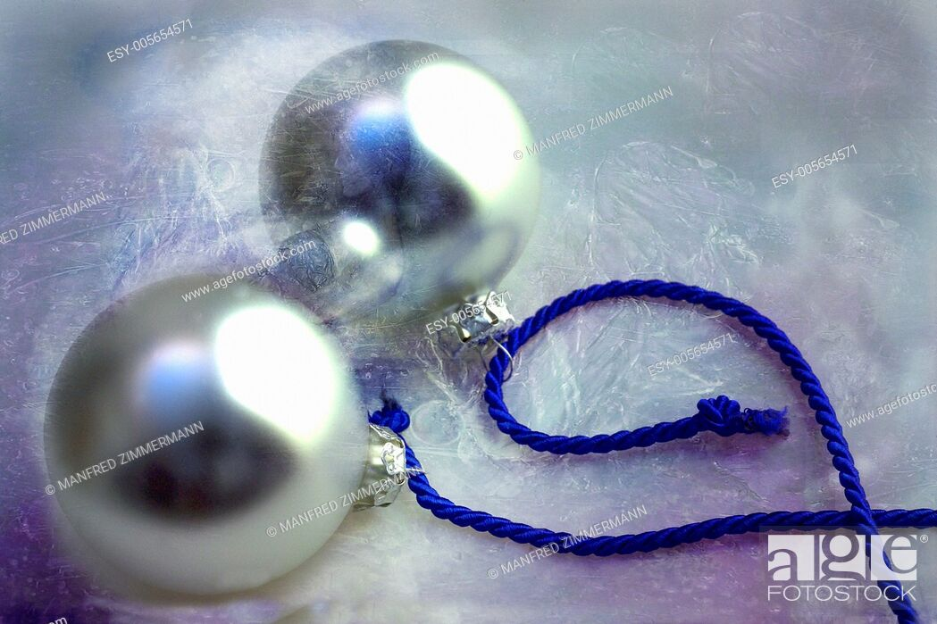 Stock Photo: Two silver Christmas baubles on blue ribbon.