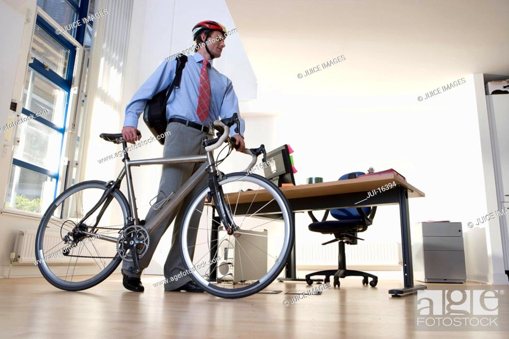 Stock Photo: Businessman in helmet with bicycle.