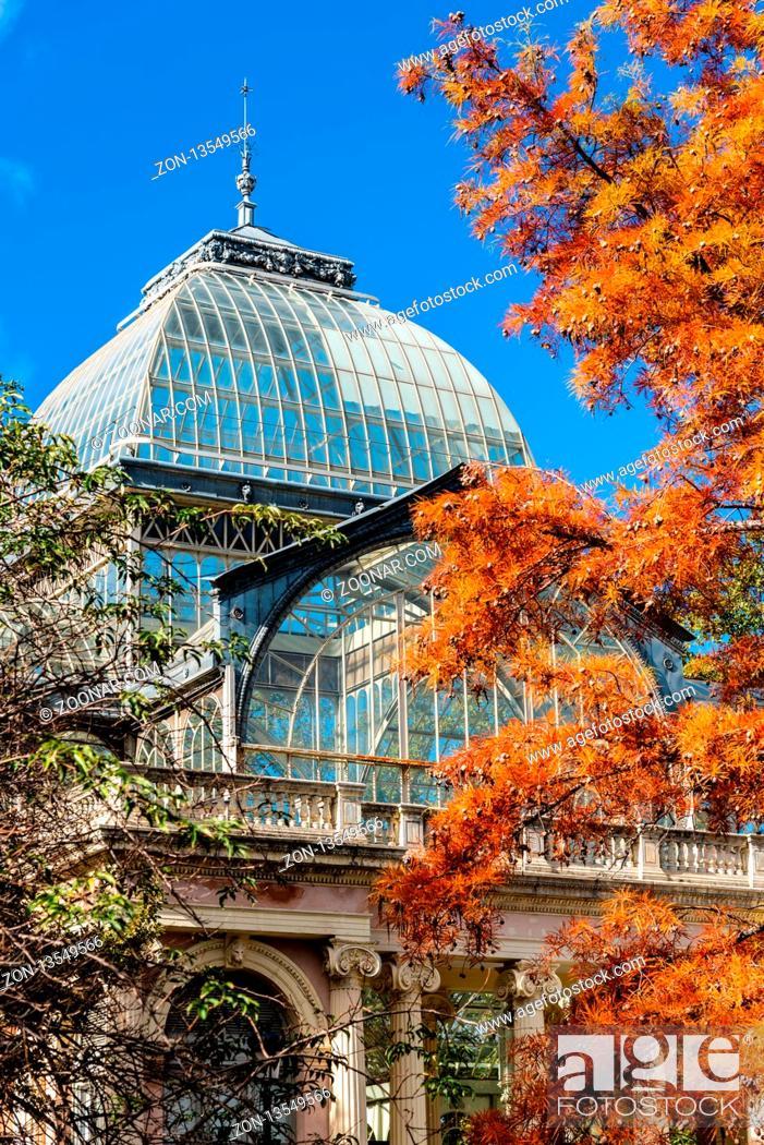 Stock Photo: Madrid, Spain - November 2, 2018: Exterior view of Crystal Palace, Palacio de Cristal, in Retiro Park. View against blue sky at autumn.