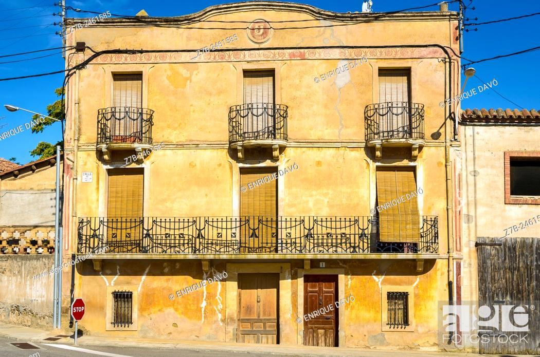 Stock Photo: A yellow house view in a street of Sentiu of Sio, Lerida province, Catalonia, Spain.