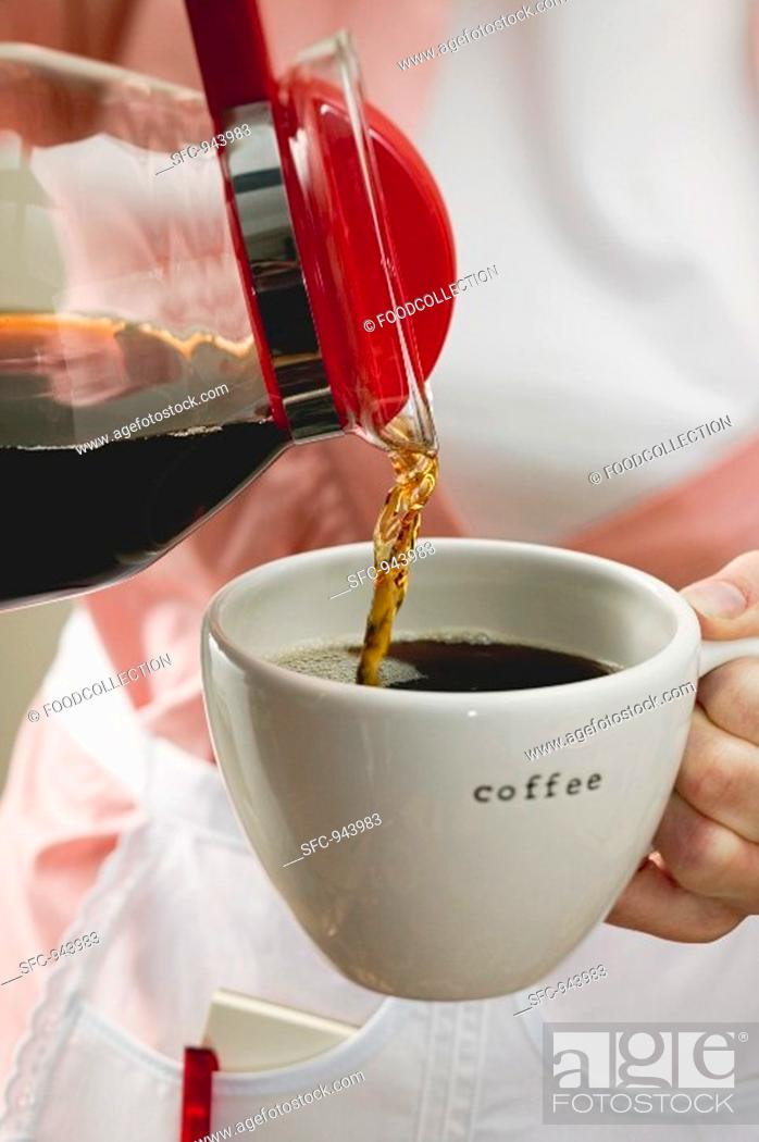 Stock Photo: Pouring coffee into a cup.