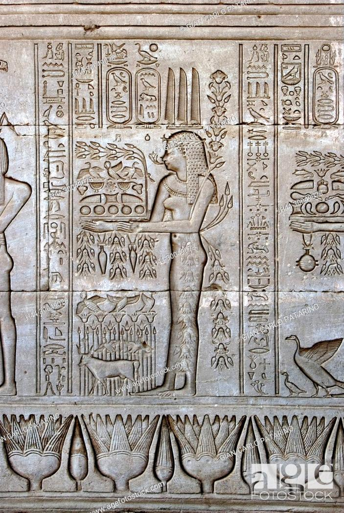 Stock Photo: Egypt,Dendera,Ptolemaic temple of the goddess Hathor.Carvings on external wall.