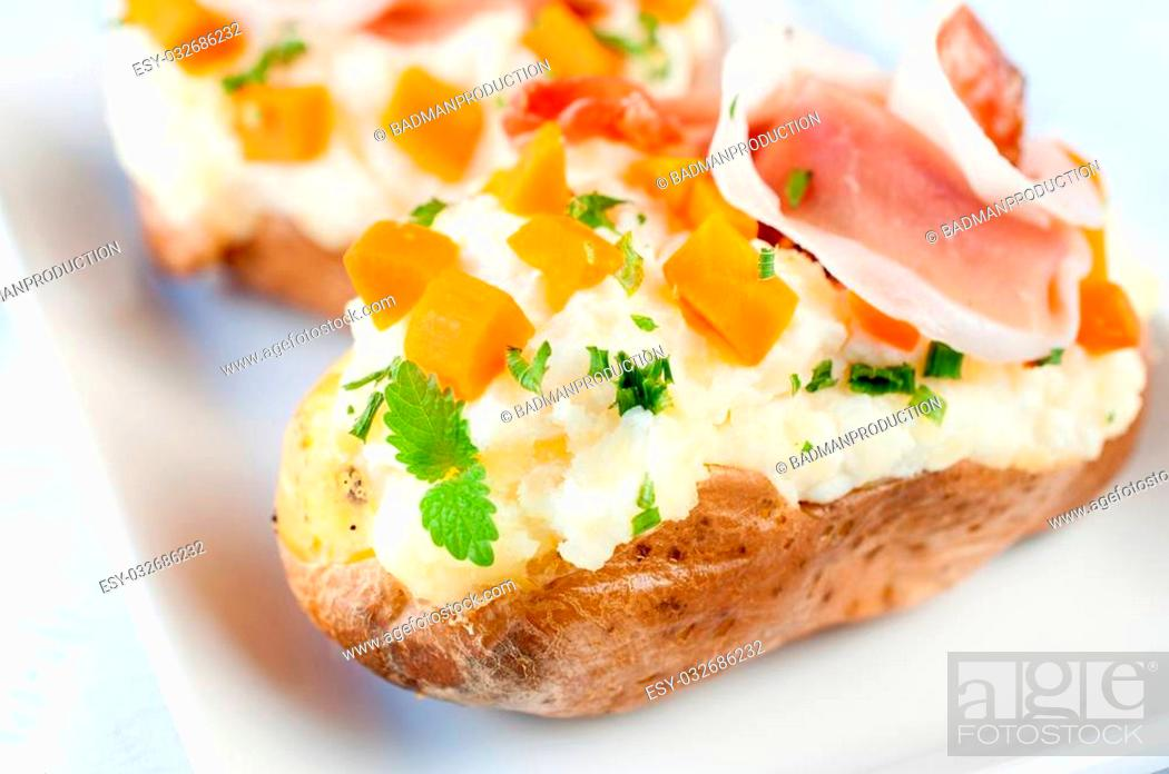 Stock Photo: Fresh baked potatoes stuffed with white cheese cream and prosciutto.