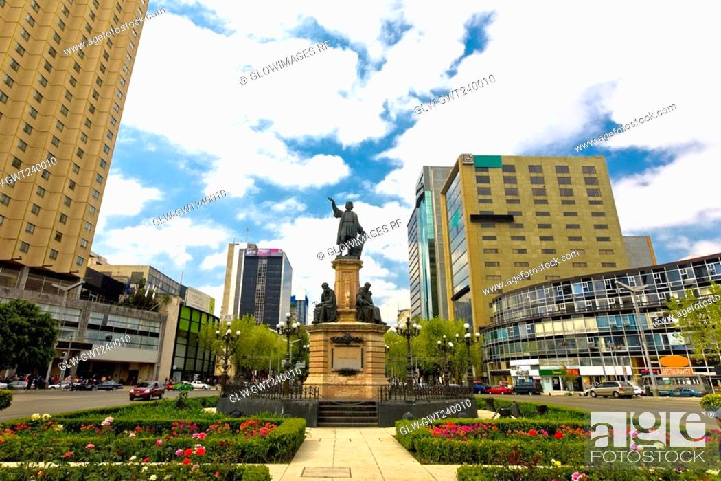 Stock Photo: Low angle view of a monument in a city, Monumento De Cristobal Colon, Mexico City, Mexico.