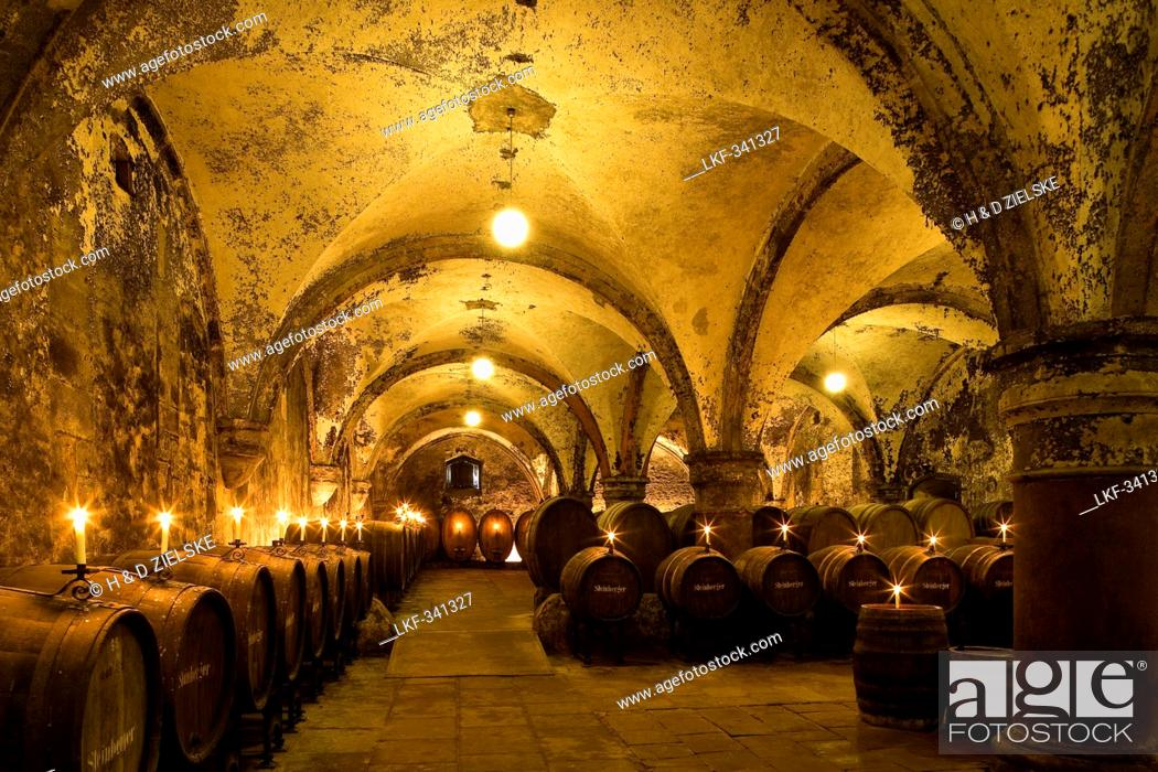 Stock Photo - Candlelit barrels inside wine cellar of Eberbach abbey a medieval monastery at Eltville am Rhein Rheingau Hesse Germany Europe & Candlelit barrels inside wine cellar of Eberbach abbey a medieval ...
