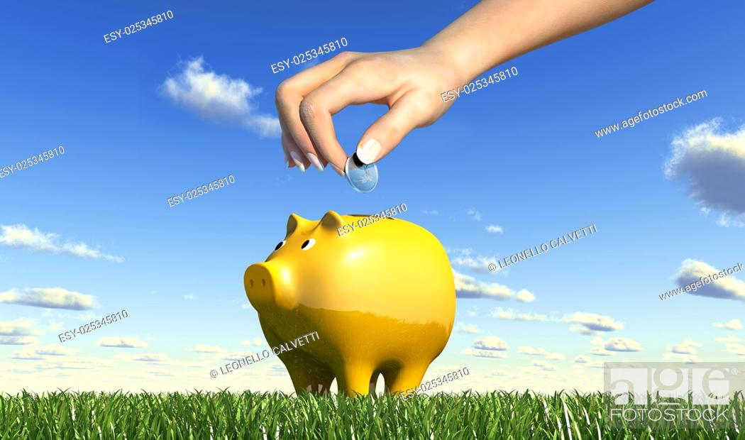 Stock Photo: Woman hand inserting a coin into a yellow ceramic piggy bank placed on a green grass meadow, viewed from a side close up, with blue sky and fluffy clouds.